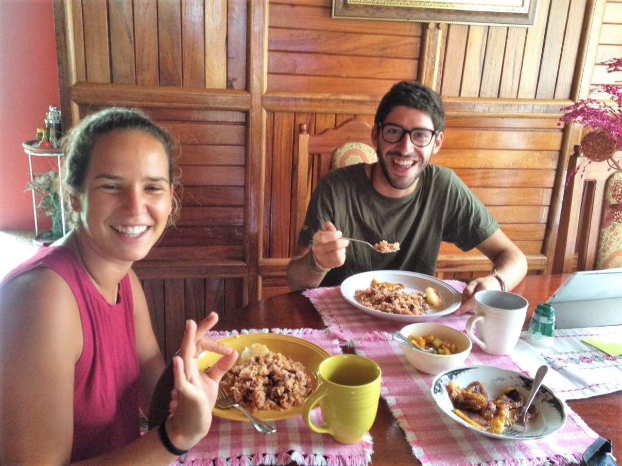 """Our happy first guests from Portugal having a traditional breakfast, """"Gallo Pinto"""" with coffee."""