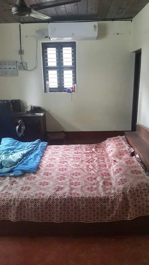 AC bedroom with balcony