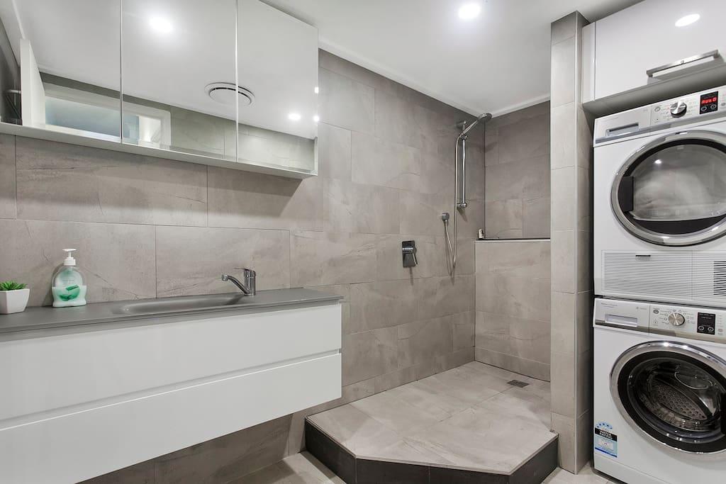Bathroom with full laundry