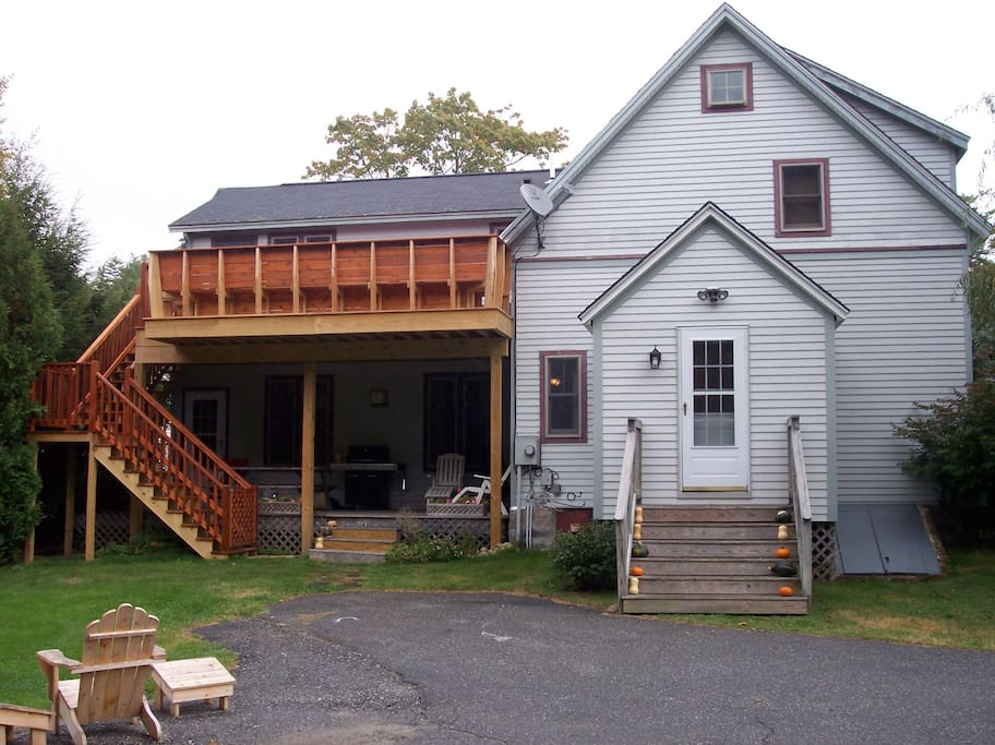 Backdoor large mudroom entrance, lower deck with grill, upper deck perfect for sunning