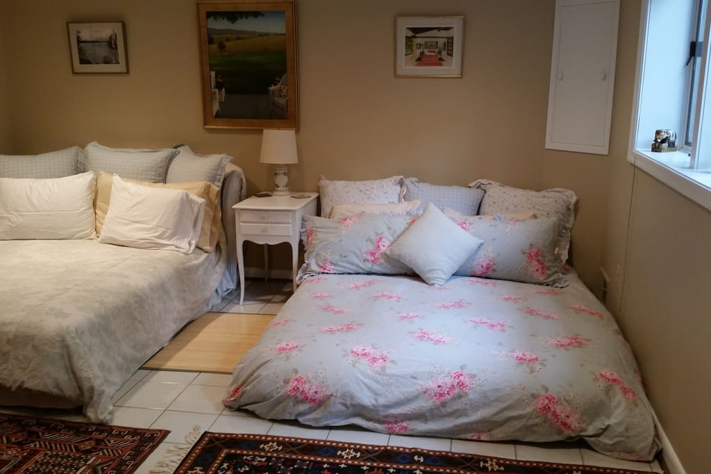Well-lit bedroom with two queen size beds and dresser. Nice Ralph Lauren and Pottery Barn linens and pillows.