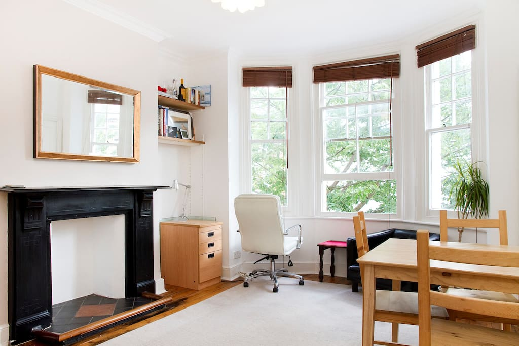 This is the bright lounge space with dining table and chairs