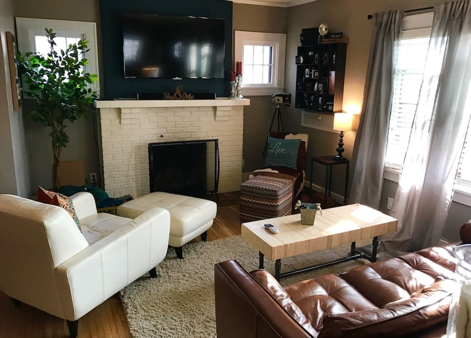 Cozy living room welcomes our guests, fully equipped with a gas fireplace, 55 inch flat screen smart tv, DIRECTV, amazon prime, and Netflix.