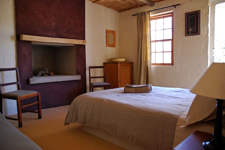 The first bedroom with it's fireplace and door to it's own little patio with seating