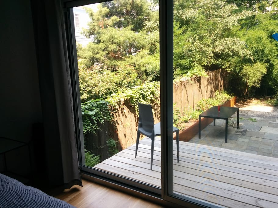 Garden view with table and chair.