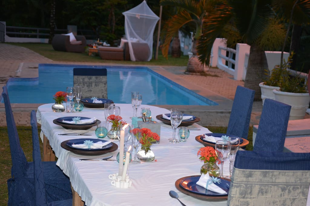 The swimming pool and outside dinner table.