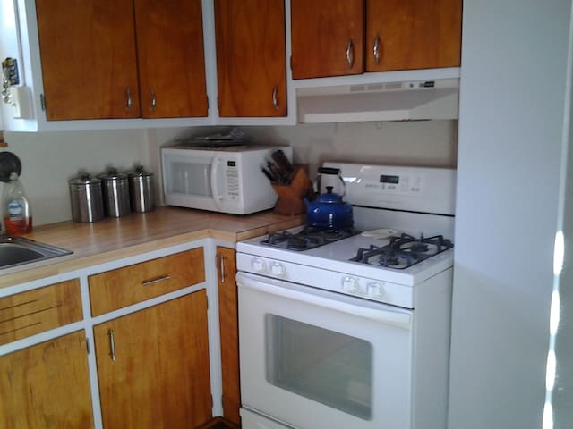Fully furn. kitchen w-stove, refrig, pots, pans, microwave, coffee pot, toaster oven, dishes, silverware, stocked with juice, coffee, tea, cream, sugar and sweeteners.