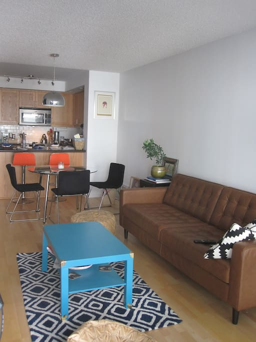 Comfy couch and a table for four