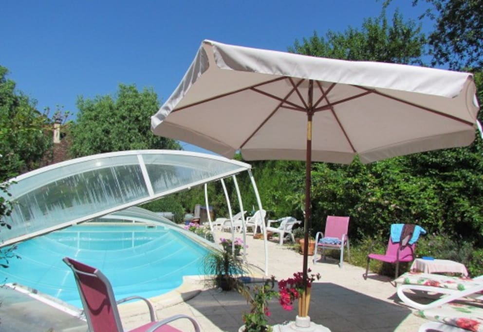 Heated Pool with sunny terrace and sun loungers.