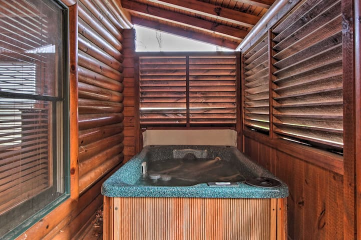 This vacation rental cabin features a hot tub!