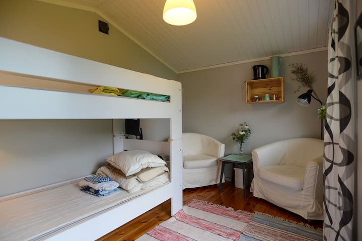 In cabin you'll find a bunkbed, 2 armchairs and a coffe table
