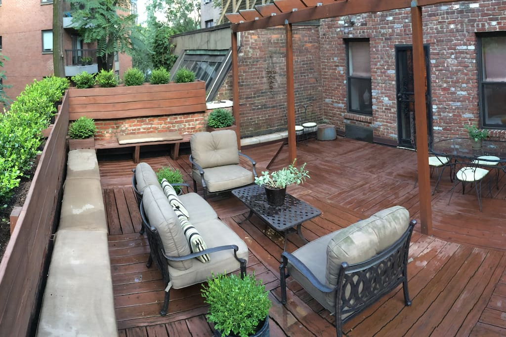 outdoor lounging and dining areas plus a wrap-around bench