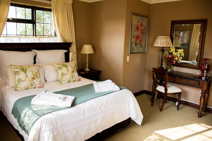 North facing, main bedroom with queen bed, dressing table and plenty of cupboard space.