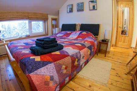 Room #3 comes with a queen bed, private bathroom, free wifi and a great view.