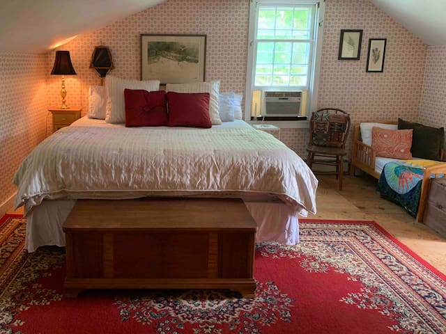 Upstairs king room with toddler bed, tv w/dvd player, desk and monitor.