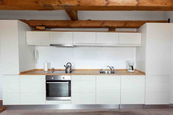 Kitchen with dishwasher, coffee maker and the basics you need for making meals