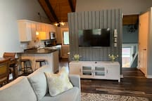 Common area - tv room with wood stove.