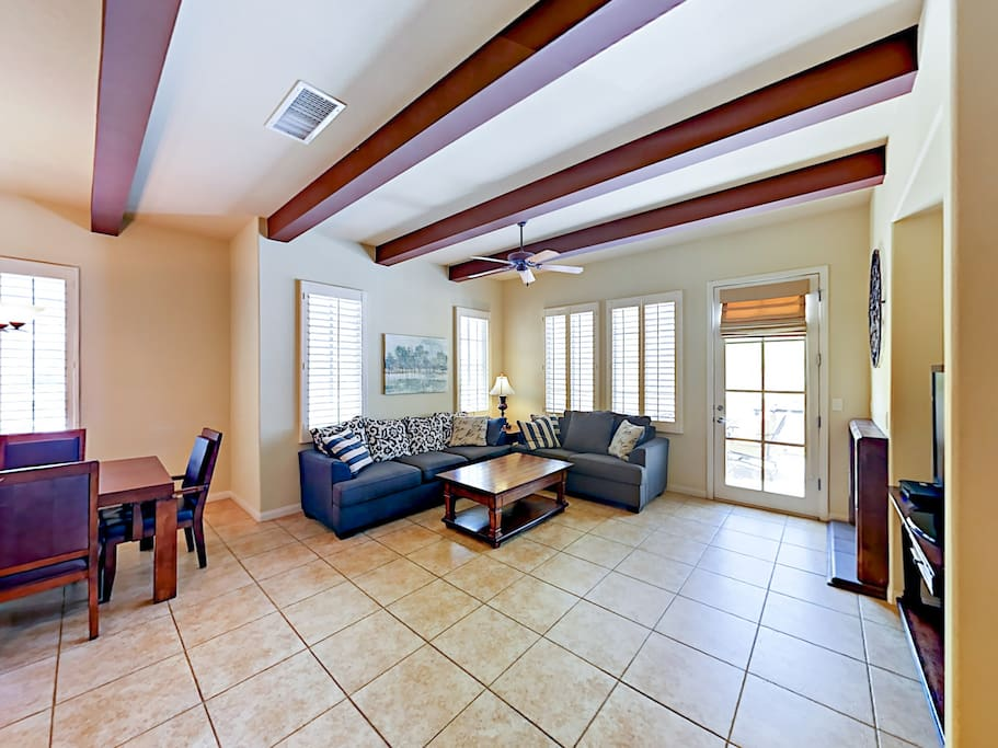 Tiled floors add a fresh feel throughout an open living area. Home is professionally managed by TurnKey Vacation Rentals.