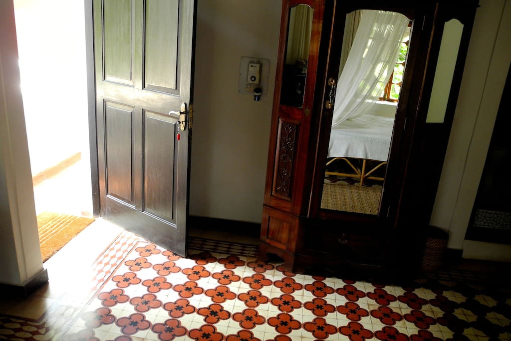 Traditonal Tiles and Antique Wardrobe