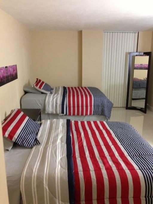 main bedroom, with 2 queen beds
