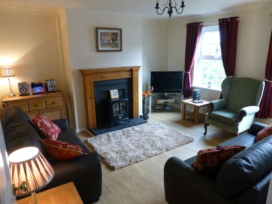 The living room, cosy, free wifi, TV, dvds, leather seating.
