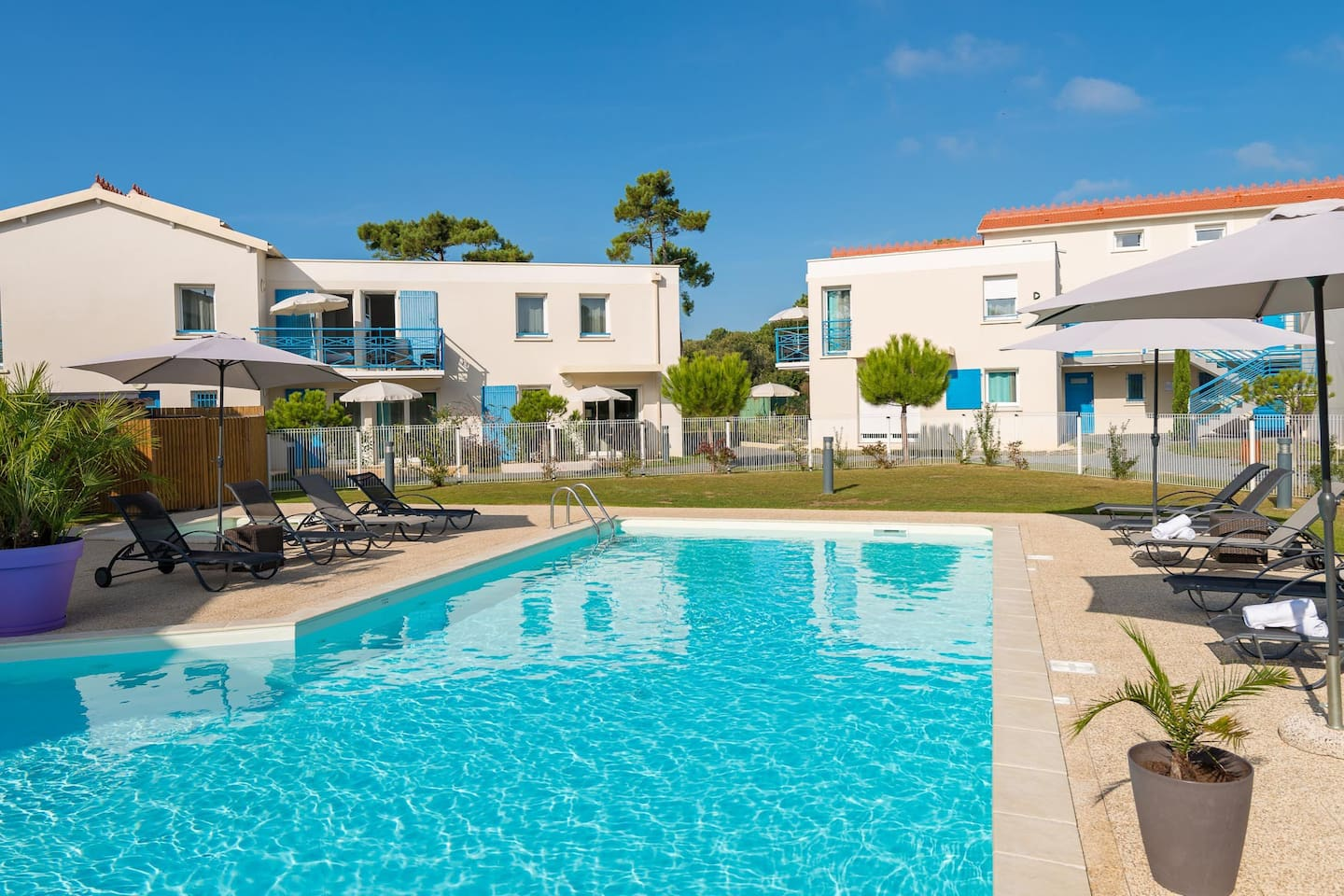Enjoy the French summer and lounge poolside.
