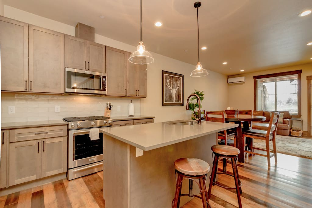 Fully stocked chef's kitchen with a large center island.