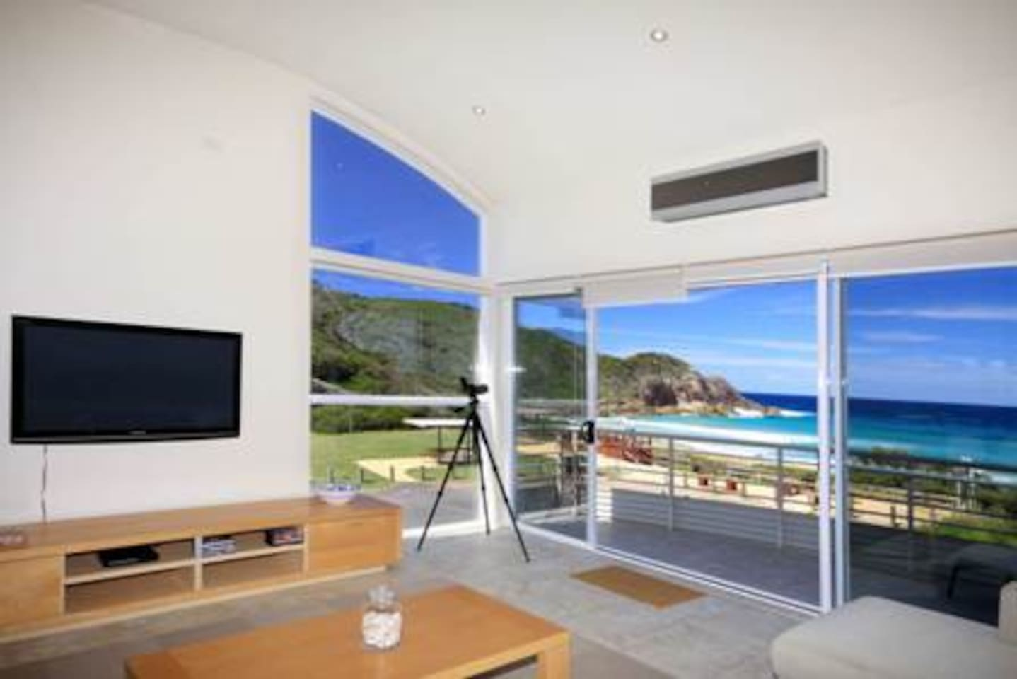 Main living area with views of North Boomerang beach and headland