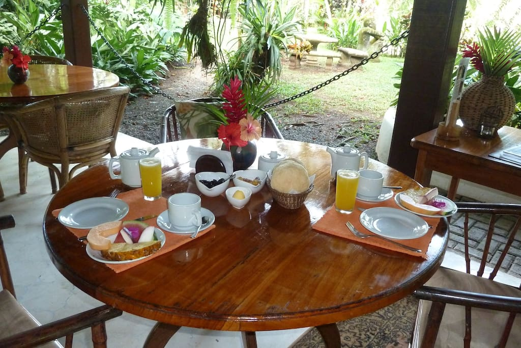Breakfast on the open air terrace over looking the tropical gardens