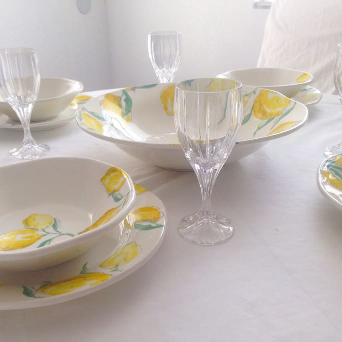 Hand painted plates from Italy and full crystal glasses