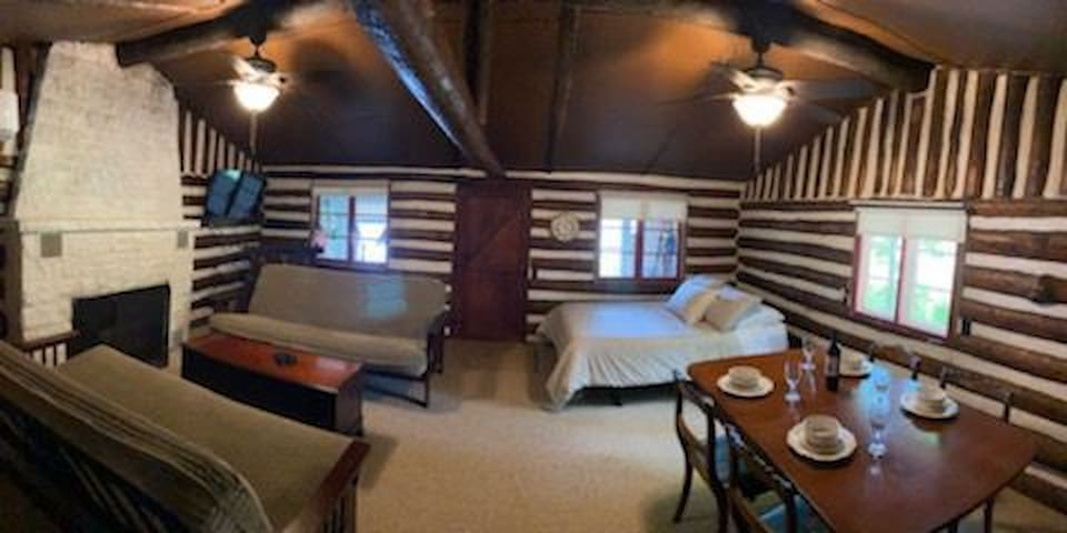 Main room, full size bed, and two full size futons.