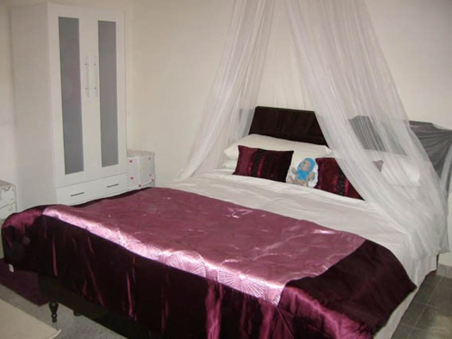 Large bedroom with double bed and daybed