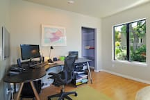 Spacious, well-lighted desk area where you can conduct business during your stay.   WIFI ready, connect to large monitor and keyboard if needed.  Printer and basic office supplies available.