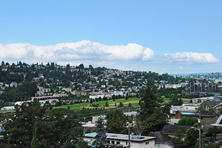 Balcony and large windows throughout apartment look out to territorial views to the west of Interbay Golf Course and Magnolia.