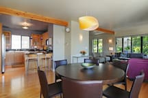 Cheery, warm and well-lighted open plan living, dining and kitchen area with large windows looking out at Northwest landscape, mountains and territorial views!   This is a great 1200 sq. ft.  space to share with your family or travel mates!