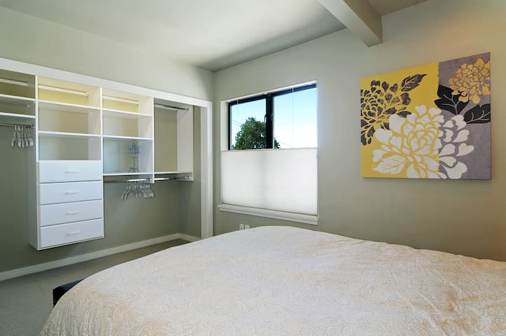 View of custom built closet space in bedroom #1 to help you quickly organize all your belongings for your stay.  Supply of hangers provided.