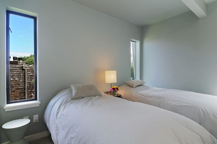 Large bedroom outfitted with two twin beds and closet space.  This is a great room to share!