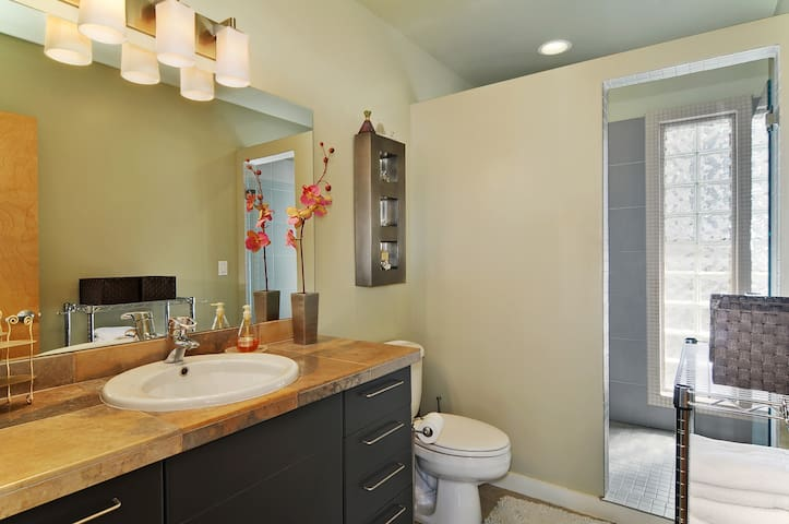 Bathroom features large walk in shower with hand rails and bench, back-saver sink counter height and is stocked with shampoo/conditioner, hair dryer/flat iron.  Towels supplied.
