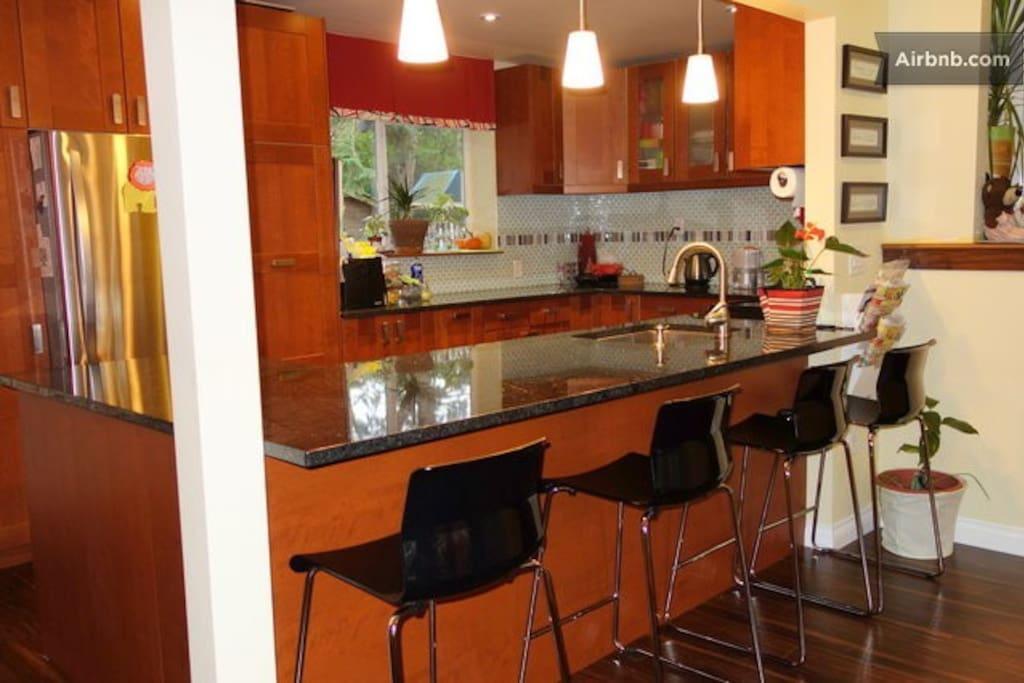 big modern kitchen with stainless steel appliances