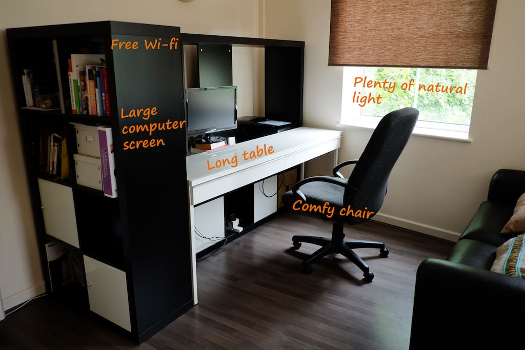 Comfy working area, with large desk, soft chair and a large computer screen. High-speed wi-fi