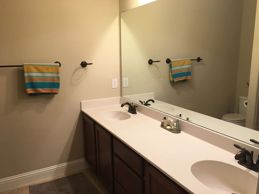 Private bath with double sink vanity and shower/bath