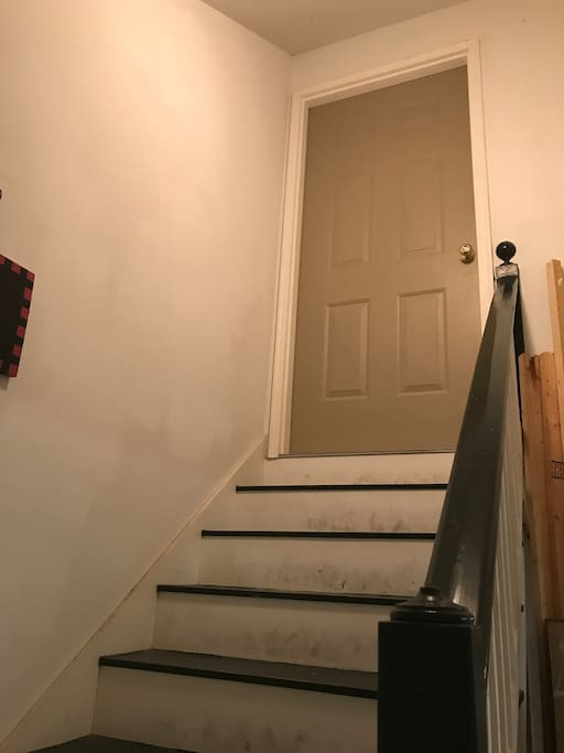 Stairs going up to apartment door