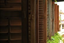 The old shutter windows in the bathroom that look into the charming back lane of Melaka