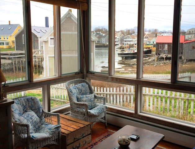 Large windows overlook the working waterfront