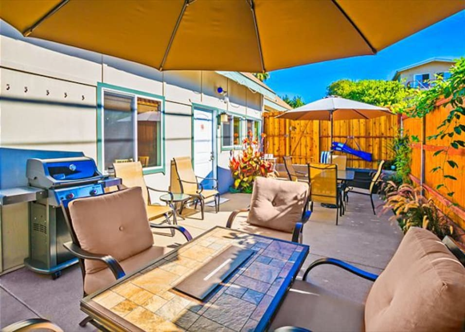 Enjoy socializing out on the patio under the huge sunbrella.