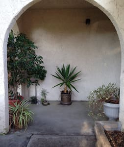 The area is very easy to get to. Train and buses close by. On a main street but quiet, safe neighborhood. Very close to airport. Parking always available at curbside. You can walk to stores and cafes, the shopping center is 2 blocks away.