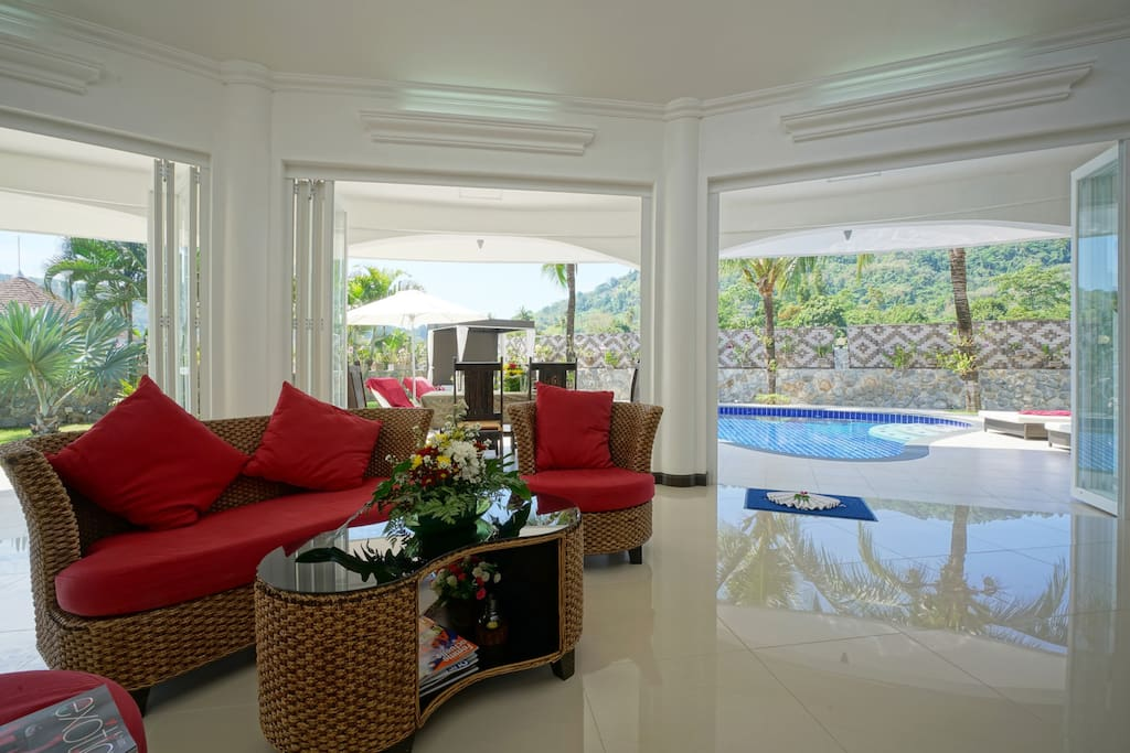 Glass-fronted open plan living room