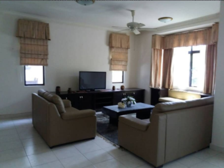 Living room area equipped with cable tv, 10mbps high speed wifi and HyppTv Everywhere.