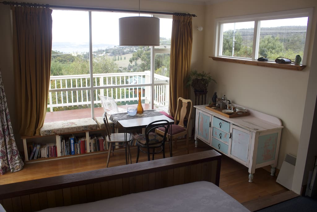 The sunroom adjacent  the room with double bed. The room can be closed and a curtain pulled across for privacy.