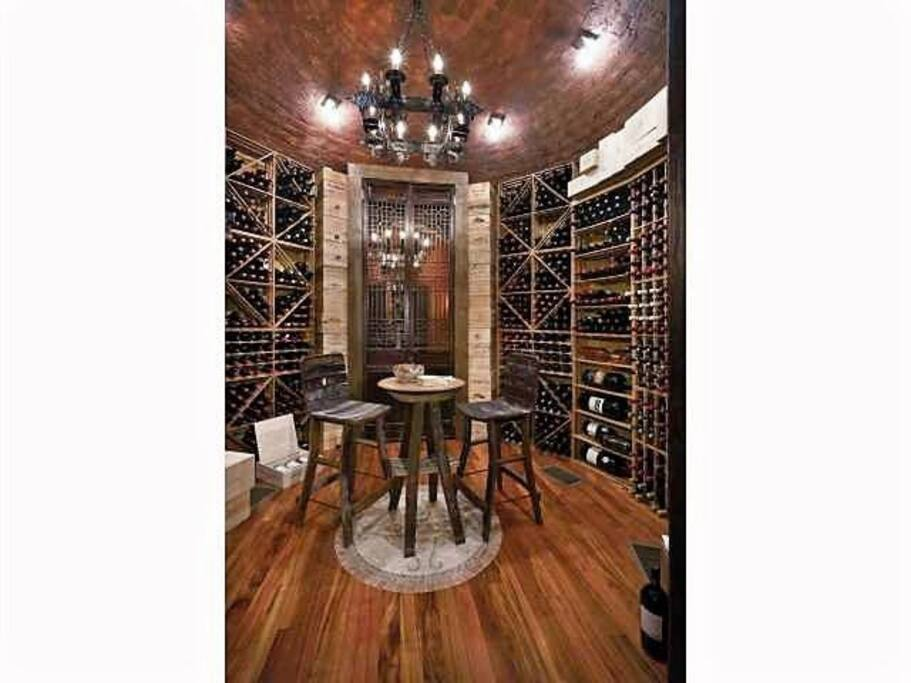 Retreat into the 2,500 bottle wine cellar